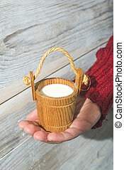Vintage wooden cup of milk