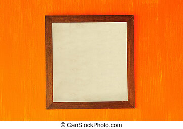 Vintage wooden picture frame on colorful wall