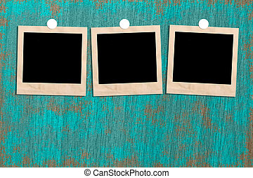 Vintage wooden picture frame on the floor. Space for text and images.