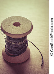 Old vintage wooden spool with a fiber dyeing