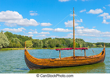 Vintage wooden Viking boat on the lake