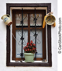 Vintage wooden window frame with hanged pottery