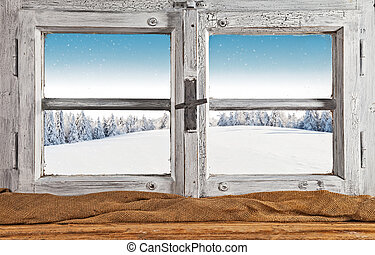 Vintage wooden window overlook winter landscape, shot from...