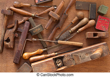 Vintage woodworking tools, including planes, chisels, whittling tools. Most of these are hand-made.
