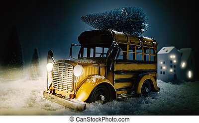 Vintage yellow bus in a Christmas snow scene