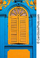 Vintage yellow window on blue wall