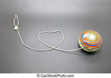 Vintage yoyo with twine rolling in heart shape