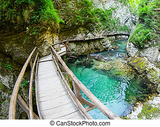 Vintgar Gorge with wooden path and pure blue water ,Bled, ...