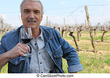 Vintner with a glass of wine