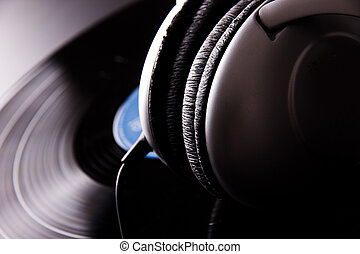 Vinyl disc with headphones close-up