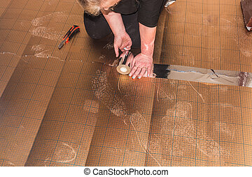 Vinyl laminate laying in old building - Woman in the laying...