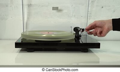 Vinyl Player Setting Up - Close up of vinyl disc on the...