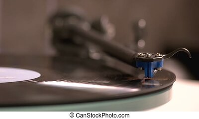 Vinyl record on a turntable record player. Retro music ...