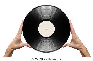 Vinyl record - Man's hands holding vinyl record.