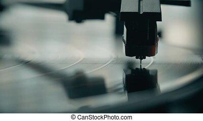 Vinyl record player needle macro shot - Vinyl record and...
