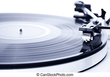 Vinyl record player - Spinning record player. Focus on the...