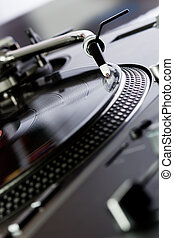 Vinyl record player spinning the disc - Turntable playing a...