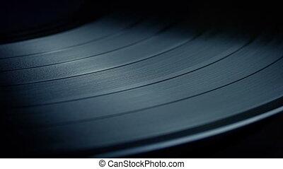 Vinyl Record Playing Closeup - Closeup of record being...