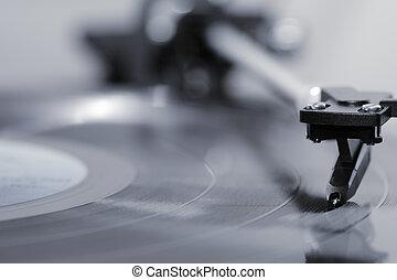 Vinyl record - Stylus on a vinyl LP record.