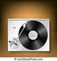 vinyl record turntable on woooden background