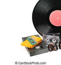 Vinyl record, video and audio cassettes isolated on white background. Free space for text.