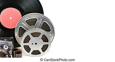 Vinyl record, video and audio cassettes isolated on white background. Free space for text. Wide photo .
