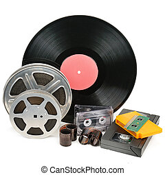 Vinyl record, video and audio cassettes isolated on white background.