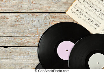 Vinyl records and musical notes.
