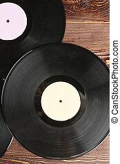 Vinyl records background, top view.