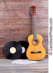 Vinyl records, guitar and musical notes.