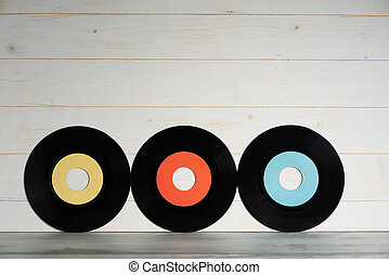 Vinyl records on white wooden background