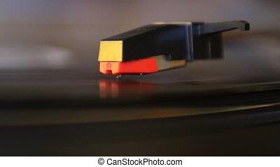 Vinyl rotating and cartridge lifting off