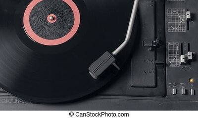 Vinyl rotating on a turntable, top view - Old gramophone...