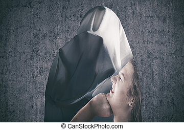 Violence against women - Shape of a covered woman expressing...