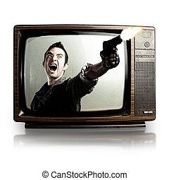 violence in tv - angry tv man shooting a gun, represents...