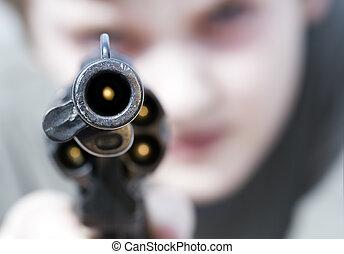 violence - Loaded gun aimed at you, focus on gun barrel...