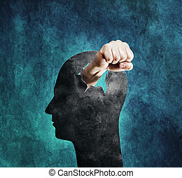 Violent Mind - Conceptual image of a fist punching through a...