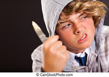 violent teen boy with knife - violent teen boy holding a...