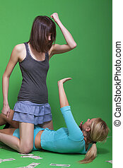 violent woman - two young women fighting on the ground over...