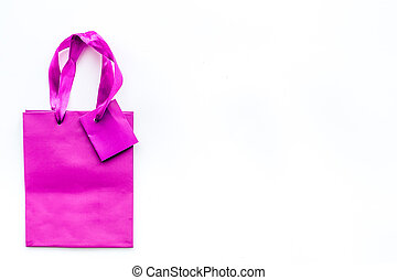 Violet bright shopping bag on white background top view copyspace