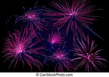 Violet fireworks on black background