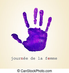a violet handprint and the text journee de la femme, womens day in french, on a beige background