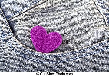 Violet heart in jeans pocket