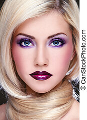 Violet makeup - Close-up portrait of young beautiful blond...