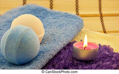 Violet salt wiih candle and bath balls