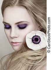 Violet smokey eyes - Close-up colored portrait of young ...
