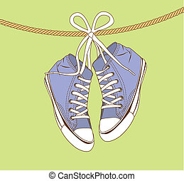 violet sneakers hanging of a rope over green background....