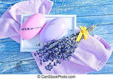 soap and lavender - violet soap and lavender on the wooden...