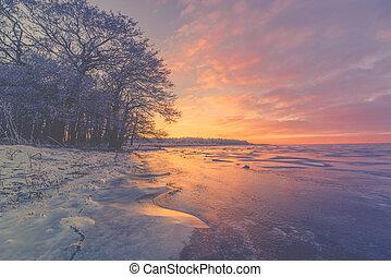 Violet sunrise over a frozen lake