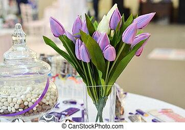 violet tulips in a vase